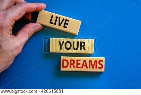 Live Your Dreams Symbol. Wooden Blocks With Words 'live Your Dreams'. Beautiful Blue Background, Bus