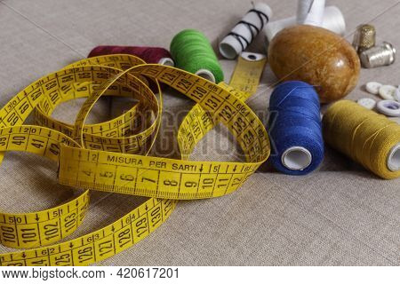 A Tailors Tape Measure With The Wording Measure For Tailors.