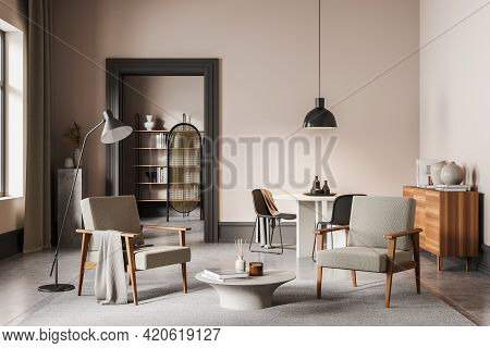 Beige And Concrete Living Room Interior With Two Vintage Armchairs On Grey Carpet, Wooden Drawer And