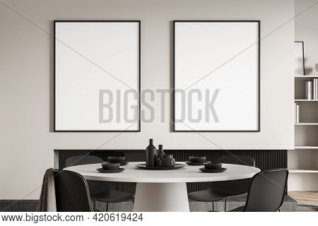 Eating Room Interior With Black Chairs And White Round Table With Dishes, Bookshelf Rack On Backgrou