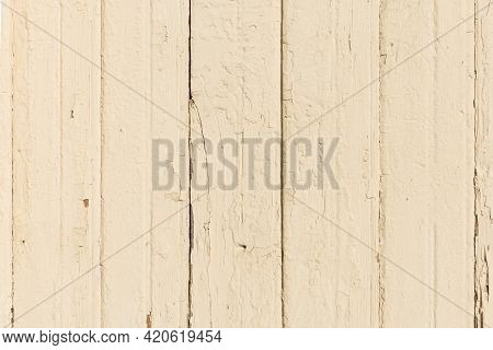 The Surface Is Made Of Vertical Old Boards Painted In Cream Color. Wooden Texture