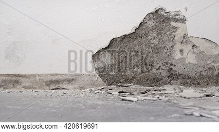 House Renovation Concept, Wall In Demolition With Plaster Rubble On Floor, White Background With Cop