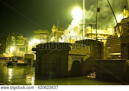 Smokes Spreading From Fire Due To Cremation Next To Ganga River In Varanasi, Located In The State Of