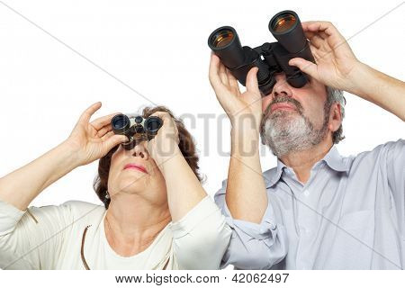 Elderly couple looks through binoculars