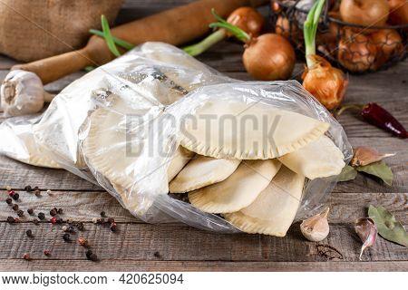 Homemade Chebureks - Russian Dumplings. Meat Dumplings, Ravioli. Dumplings With Stuffing On A Wooden