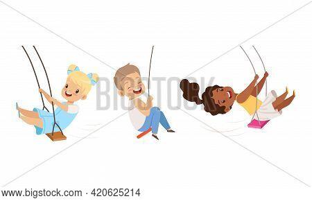 Set Of Cute Preschool Kids Swinging On Rope Swings, Happy Boys And Girls Having Fun Outdoors Cartoon