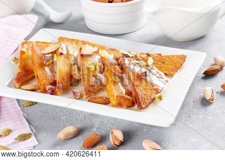 Shahi Tukda Or Double Ka Meetha Is A Bread Pudding In Ghee, Garnish With Condensed Milk, Nuts & Mawa