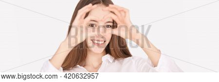 Pretty Girl Indoor Portrait. Light Background. Female Teenager Person. Long Brow Hair. Eye Care. Hea