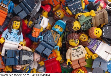 Tambov, Russian Federation - May 16, 2021 A Pile Of Lego Minifigures. Close Up.