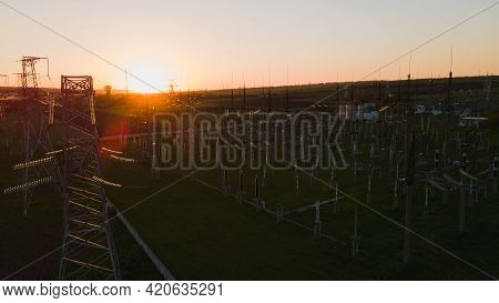 Silhouette High Voltage Electric Tower On Sunset Time And Sky On Sunset Time Background. High Voltag