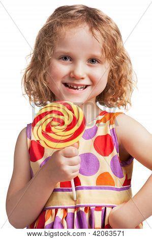 Happy Little Girl With A Lollipop