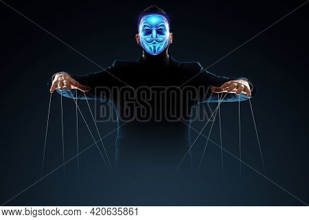 Man In Electronic Hologram Mask, Hacker, Puppeteer. The Concept Of World Conspiracy, World Governmen
