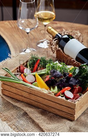 Chopped Fresh Vegetables In A Wooden Box On A White Background. Banquet Festive Dishes. Gourmet Rest