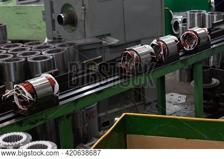 Electric Motors Manufacture In Industrial Company - Stators On Assembly Line Of Semi-automated Manua