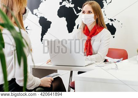 Travel Agent Having Client In Modern Office Of Tour Agency, Giving Passport After Check-in, Booking