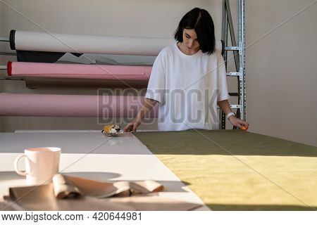 Woman Tailor Preparing To Cut Fabric Work In Garment Studio. Female Clothes Designer Busy In Atelier