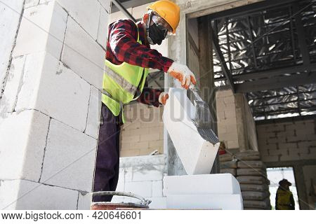 Professional Workers Use Plaster To Glue Walls In Private Homes. Masonry, Repair And Foam Constructi