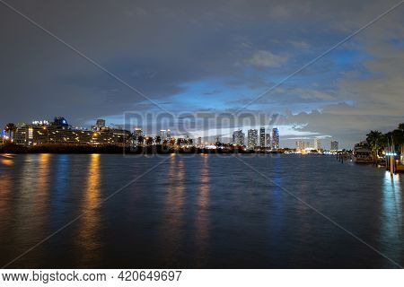 Miami Night. Cruise Ship In The Port Of Miami At Sunset With Multiple Luxury Yachts. Night View Of C