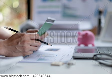 Business Man Hands Holding Saving Account Passbook With Calculator, Account And Saving Concept