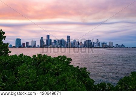 Miami, Florida, Usa Skyline On Biscayne Bay, City Night Backgrounds. Panoramic View Of Miami At Suns