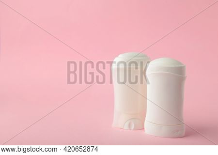 White Antiperspirant Deodorant On Pink Background. Skin Care Concept. Copy Space, Top View.