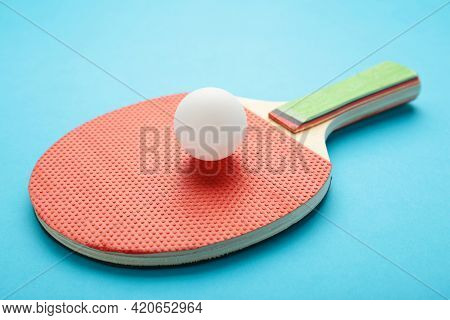 Ping Pong Paddle With Ball On Blue. Table Tennis Racket. Top View