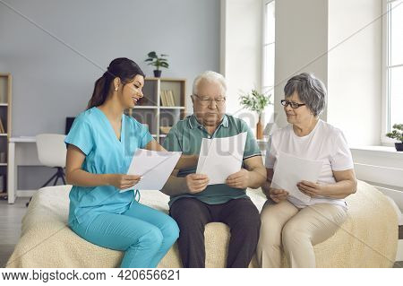 Home Care Nurse Helps Senior Patients Understand And Fill Out Homecare Service Contract
