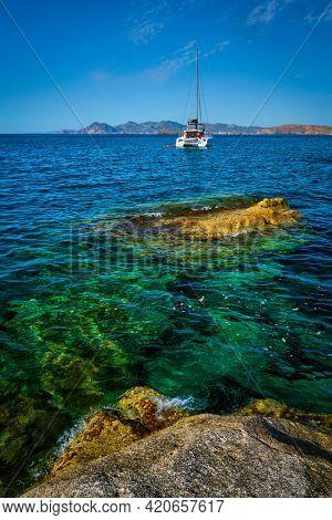 Yacht boat in Aegean sea at white rocks of Sarakiniko Beach, Milos island , Greece