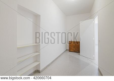 Empty Small Room With White Walls And Built-in Niche For Shelves In An Old Flat Before Renovation.