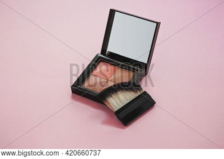 Four Colors Female Compact Face Powder Close Up On Pink Background, Cosmetics And Makeup Concept