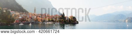 Early Morning View Of The Como Lake With The Village Of Varenna, Italy, And Clear Sky, With Fog, Sof