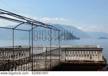 Varenna, Italy - July 28,2018: Cloudy Misty Morning View Of The Como Lake From The Botanical Garden