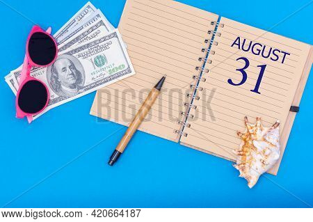 31st Day Of August. Travel Concept Flat Lay - Notepad With The Date Of 31 August Pen, Glasses, Dolla