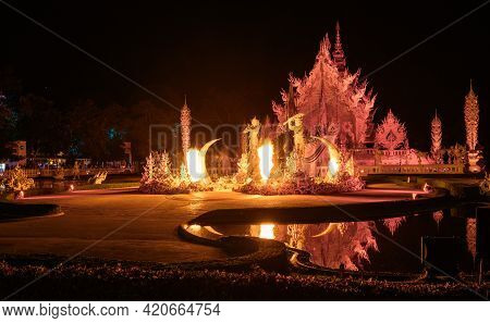 Night View Of Wat Rong Khun (other Name White Temple) With Illuminated Lights Show. One Of Iconic To