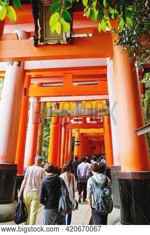 Kyoto, Japan - 18 May, 2015: Fushimi Inari Taisha Shrine In Kyoto, Japan With Beautiful Red Gate And