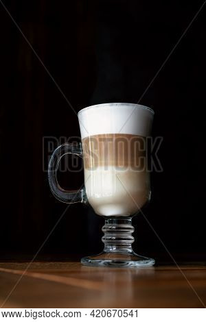 Coffee Latte In A Glass Cup With Black Background. Three-layer Latte On A Dark Background. Coffee La