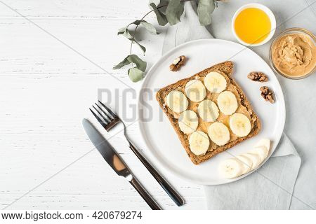 Homemade Peanut Butter Sandwich With Bananas And Honey.