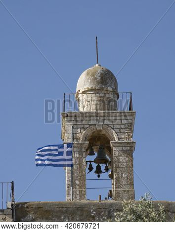Jerusalem, Israel - May 6th, 2021: The Mar Elias Monastery Bell Tower, With The Greek Flag Beside It