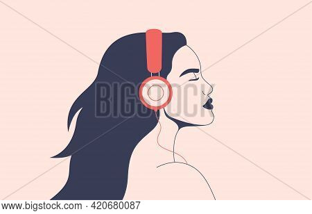 Confident Woman Listens To Music With Headphones. Girl With Flying Hair In Earphones Enjoying The So