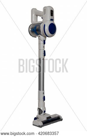 Upright Vacuum Cleaner. The Male Hand Holds Hold A Modern Cordless Battery-powered Vacuum Cleaner Is