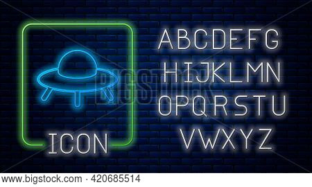 Glowing Neon Ufo Flying Spaceship Icon Isolated On Brick Wall Background. Flying Saucer. Alien Space