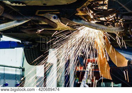 Mechanic Grinding Car Body By Grinder. Auto Body Repair