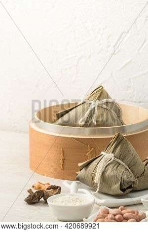 Zongzi. Rice Dumpling For Dragon Boat Festival On Bright Wooden Table Background With Window.