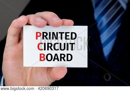 Businessman Holding Business Card With Pcb Printed Circuit Board Text.