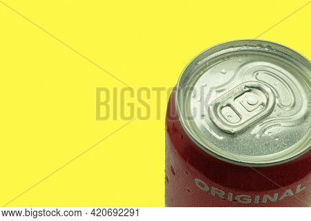 Warsaw, Poland - April 26, 2021: Coca-cola Can On A Yellow Background. Copy Space For Text. Water Dr