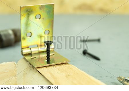 The Self-tapping Screw Is Screwed Into The Board. Screwing A Self-tapping Screw Into A Wooden Board