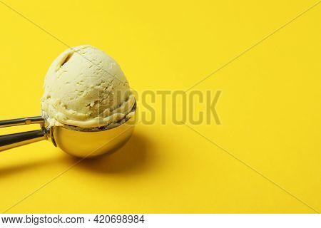 Scoop With Ice Cream On Yellow Background