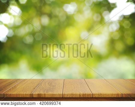Empty Wooden Table Top With Foliage Bokeh Background Suitable For Montage Product Display 3d Renderi