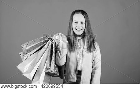 Happy Child In Shop With Bags. Shopping Day Happiness. Buy Clothes. Fashionista Addicted Buyer. Fash