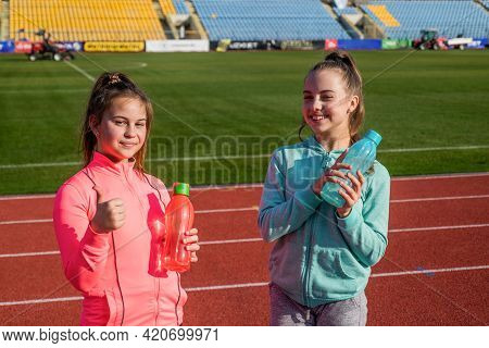 Happy Kids Hold Sports Drinks. Sports And Hydration. Water And Hydration